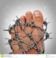 Foot wrapped in barbed wire